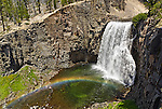 Large and scenic Rainbow Falls in the Mammoth Lakes area of the Eastern Sierras in California. Showing it's namesake, this impressive rainbow appears around noon.