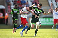 Joe Quigley of Dagenham and Redbridge and Aaron Cunningham of Hartlepool United during Dagenham & Redbridge vs Hartlepool United, Vanarama National League Football at the Chigwell Construction Stadium on 14th September 2019