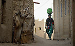 A woman walks in the street in Timbuktu, the northern Mali city that was seized by Islamist fighters in 2012 and then liberated by French and Malian soldiers in early 2013. During the jihadists' rule, women and girls were not allowed in public unless they were completely covered.