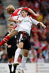 Wrexham's Neil Roberts challenges Liverpool's Gabriel Palletta