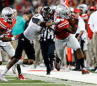 Cincinnati Bearcats cornerback Grant Coleman (13) forces Ohio State Buckeyes running back Ezekiel Elliott (15) out of bounds during the second quarter of the NCAA football game at Ohio Stadium in Columbus on Sept. 27, 2014. (Adam Cairns / The Columbus Dispatch)
