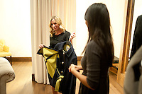 Assistant manager at A.Line Boutique Mayra Sanchez (cq, right) talks about corduroy pants with Bethany Diamond (cq) during a champagne and shopping event in Denver, CO, Thursday, December 15, 2011. Retailers are using various ways to get shoppers into their stores to shop for the holidays including serving alcohol and food...Photo by Matt Nager