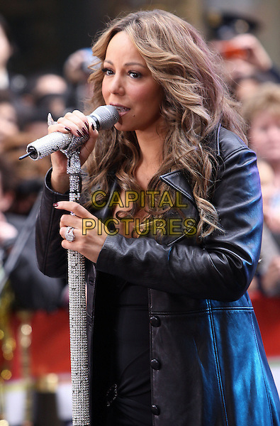 "MARIAH CAREY .performs live on NBC's ""TODAY Show"", New York, NY, USA, .2nd October 2009..concert music gig on stage performing half length microphone curly wavy hair black leather  diamante sparkly rhinestone jewel encrusted butterfly ring stand mic  singing coat  .CAP/ADM/PZ.©Paul Zimmerman/Admedia/Capital Pictures"