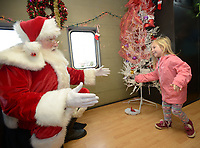 NWA Democrat-Gazette/ANDY SHUPE<br /> Saturday, Dec. 1, 2018, during the annual Christmas Train at the Arkansas &amp; Missouri Railroad in Springdale. The event features a 40-minute ride to Johnson and back aboard a 1940s-era passenger car with Christmas carols. Santa Claus sat for photographs with families in a caboose while games and pony rides were available at the depot.