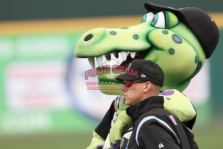 Umpire John Bostwick with Rancho Cucamonga Quakes mascot Tremor during game against the High Desert Mavericks at The Epicenter in Rancho Cucamonga,California on May 8, 2011. Photo by Larry Goren/Four Seam Images