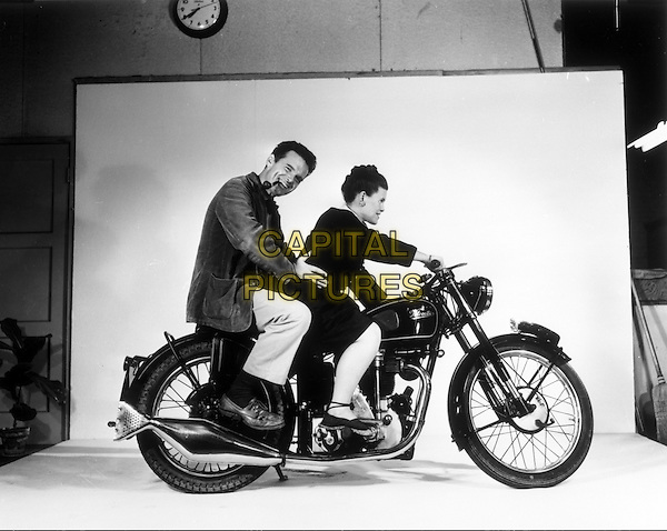 Charles and Ray Eames posing on a Velocette motorcycle,1948<br /> in Eames: The Architect &amp; The Painter (2011) <br /> *Filmstill - Editorial Use Only*<br /> CAP/NFS<br /> Image supplied by Capital Pictures