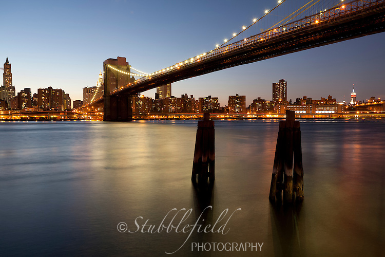 Brooklyn Bridge and the Manhattan Skyline as seen from Brooklyn across the East River.