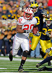 University of Wisconsin freshman running back James White (20) evades a University of Michigan defender on his way to a touchdown run in a Big Ten Conference game at Michigan Stadium in Ann Arbor, MI on November 20, 2010. White rushed for 181 yards and two touchdowns in Wisconsin's 48-28 victory over Michigan. (Photo by Bob Campbell)