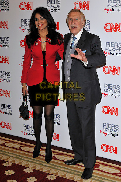 WILNELIA MERCED FORSYTH & BRUCE FORSYTH .attending the launch of 'Piers Morgan Tonight' on CNN at Mandarin Oriental Hyde Park, London, England, UK, December 7th, 2010..full length married couple husband wife red jacket suit tie blue grey gray waistcoat dress hand gesture funny .CAP/PL.©Phil Loftus/Capital Pictures.