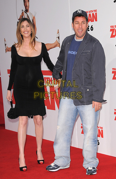 "JACKIE TITONE & ADAM SANDLER.The Columbia Pictures' World Premiere of ""You Don't Mess with the Zohan"" held at The Chinese Theatre in Hollywood, California, USA..May 28th, 2008        .full length black dress cleavage blue jacket baseball cap hat married husband wife pregnant holding hands jeans denim.CAP/DVS.©Debbie VanStory/Capital Pictures."