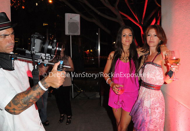 Elyse Walker {r} being filmed at The 5th annual Pink Party celebration to Benefit Cedars-Sinai Women's Cancer Research Institute at the Samuel Oschin Comprehensive Cancer Institute, event held at La Cachette Bistro in Santa Monica, California on September 12,2009                                                                   Copyright 2009 DVS / RockinExposures