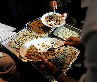 Bee larvae are prepared and added to  rice dishes at a bug eating party in Tokyo, Japan. The bug eating movement is gaining in popularity in Japan where bug eating gourmet cooking parties are sold-out.  The insects are seen as the ultimate challenge in the world's gastronomical capitol but alo seen as an important alternative source of protein for the future and even the Japanese Space Program is looking into using insects as food in space travel.