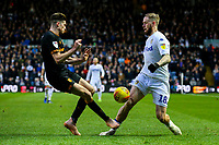 Leeds United's Pontus Jansson is tackled by Hull City's Reece Burke<br /> <br /> Photographer Alex Dodd/CameraSport<br /> <br /> The EFL Sky Bet Championship - Leeds United v Hull City - Saturday 29th December 2018 - Elland Road - Leeds<br /> <br /> World Copyright © 2018 CameraSport. All rights reserved. 43 Linden Ave. Countesthorpe. Leicester. England. LE8 5PG - Tel: +44 (0) 116 277 4147 - admin@camerasport.com - www.camerasport.com
