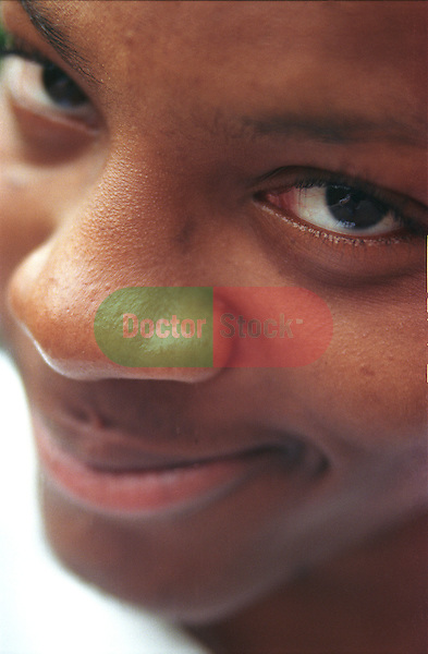 African American man (18 years) close up staring into camera smiling