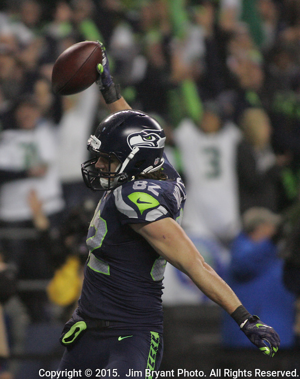 Seattle Seahawks  tight end Luke Willson (82) celebrates by spiking the ball in the end zone after scoring a 25-yard touchdown against the Carolina Panthers   in the NFC Western Division Playoffs  at CenturyLink Field in Seattle, Washington on January 10, 2015.The Seahawks beat the Panthers 31-17. ©2015. Jim Bryant Photo. All Rights Reserved.