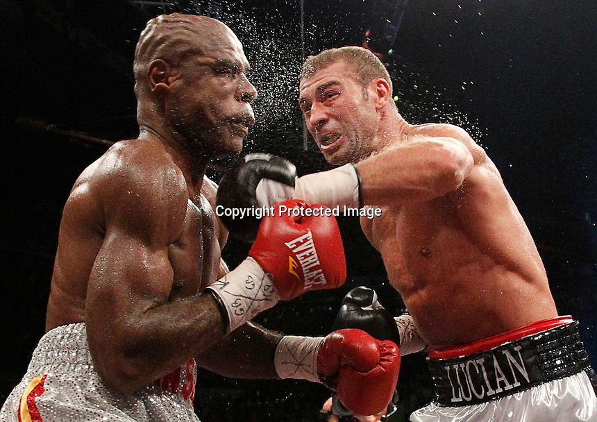 IBF Super Middleweight champion Lucian Bute punches Glen Johnson during their IBF Super Middleweight championship fight at the Colisee de Quebec in Quebec City, November 5, 2011. Photo by Mathieu Belanger/Reuters