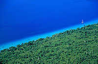 Lush coast and blue waters of the sea surrounding Mosso Island, Vanuatu.