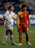 Christie Rampone, Wang Yihang.  The U.S. tied China, 1-1, during an international friendly at PPL Park in Chester, PA.