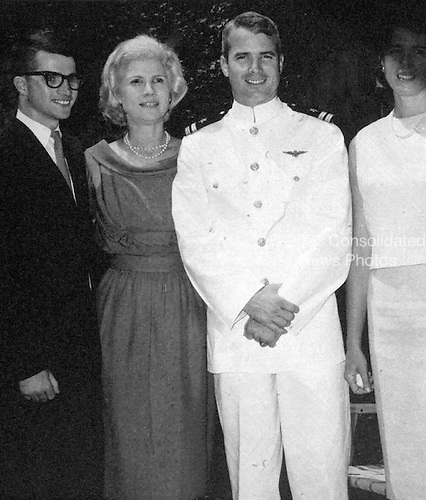 Washington, DC - (FILE) -- Photo from the office of United States Senator John McCain (Republican of Arizona), the presumptive 2008 Republican nominee for President of the United States, taken on July 3, 1965 in Philadelphia showing his mother, Roberta McCain, left center, and her son John S. McCain III, right center..Credit: Courtesy Sen. McCain via CNP