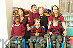 Junior infants who started school at St. Ita's and Joseph's School, Tralee were front l-r: Vanessa Akintope, Patrick O'Brien and Daniel Collins. Back l-r: Marie O'Connor (Special Needs Assistant) Khizar Baig, Caroline Morrissey (Teacher) and Mary Ahern (Special Needs Assistant).