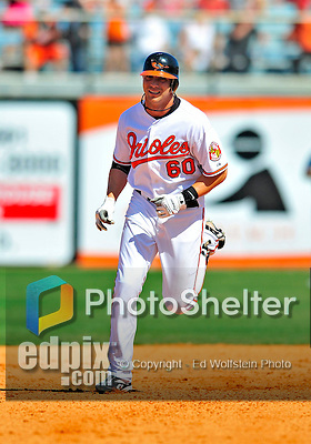 14 March 2009: Baltimore Orioles' outfielder Nolan Reimold 'rounds the bases after hitting a home run during a Spring Training game against the Boston Red Sox at Fort Lauderdale Stadium in Fort Lauderdale, Florida. The Orioles defeated the Red Sox 9-8 in the Grapefruit League matchup. Mandatory Photo Credit: Ed Wolfstein Photo