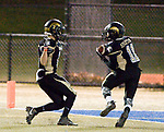 WATERBURY, CT-112117JS14- WCA's Tyler Glenn (11) pulls in a 22-yard touchdown reception in front of teammate Jacob Torres (2) during their game against Gilbert-Northwestern Tuesday at Municipal Stadium in Waterbury. <br /> Jim Shannon Republican-American