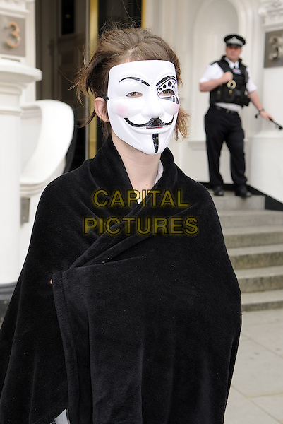 Julian Assange supporters continue to demonstrate in front of the Ecuadorian Embassy in Knightsbridge, London, England..August 23rd 2012.gv general half length black cape guy fawkes mask .CAP/BK/PP.©Bob Kent/PP/Capital Pictures