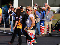 May 16, 2014; Commerce, GA, USA; NHRA funny car driver Courtney Force laughs during qualifying for the Southern Nationals at Atlanta Dragway. Mandatory Credit: Mark J. Rebilas-USA TODAY Sports