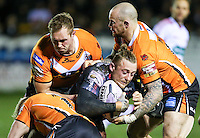 Picture by Alex Whitehead/SWpix.com - 06/03/2015 - Rugby League - First Utility Super League - Castleford Tigers v Wigan Warriors - the Mend A Hose Jungle, Castleford, England - Wigan's Josh Charnley is tackled by Castleford's Oliver Holmes, Scott Wheeldon and Nathan Massey.
