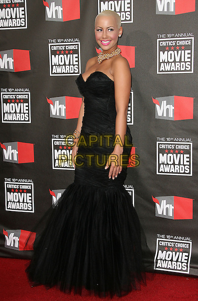AMBER ROSE .at The16th Annual Critics' Choice Movie Awards held at The Hollywood Palladium in Hollywood, California, USA, January 14th, 2011..full length long maxi dress fishtail gown strapless black cleavage tulle .CAP/RKE/DVS.©DVS/RockinExposures/Capital Pictures.