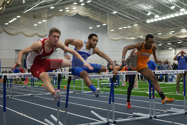 Louisville sophomore Calvin Arsenault (left), UK junior Brandon Bagley (center), and Tennessee senior Terry Benson (right) in the men's 60 meter hurdles during the UK Invitational Track & Field Meet on January 12th, 2013 at the Nutter Field House. Photo by Adam Chaffins | Staff