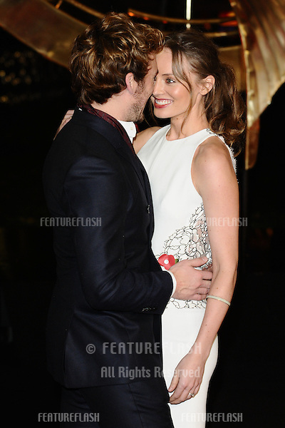 "Sam Claflin and Laura Haddock arriving for the World Premiere of ""The Hunger Games: Catching Fire"" in Leicester Square, London. 11/11/2013 Picture by: Steve Vas / Featureflash"