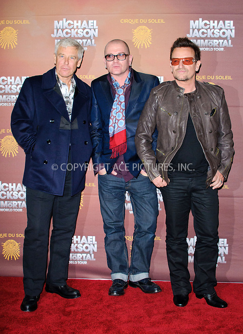 WWW.ACEPIXS.COM....US Sales Only....October 12 2012, London....Adam Clayton (L) and Bono (R) at the European premiere of 'Michael Jackson: The Immortal World Tour' at the O2 Arena on October 12 2012  in London....By Line: Famous/ACE Pictures......ACE Pictures, Inc...tel: 646 769 0430..Email: info@acepixs.com..www.acepixs.com