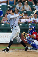 Omaha Storm Chasers outfielder Wil Myers #8 doubles during the Pacific Coast League baseball game against the Round Rock Express on July 20, 2012 at the Dell Diamond in Round Rock, Texas. The Chasers defeated the Express 10-4. (Andrew Woolley/Four Seam Images).