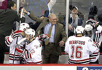 Head Coach Dean Blais (center) celebrates UNO's first win over Wisconsin. The schools hadn't met since 2003, but Wisconsin entered the game 5-0-0 all-time against UNO. No. 16 UNO beat No. 7 Wisconsin 4-1 in front of a school-record crowd of 15,137 Friday night at Qwest Center Omaha.  (Photo by Michelle Bishop)
