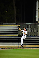 UCF Knights left fielder Austin Murphy (12) watches as a home run by Nico Ramos (not shown) leaves the stadium during a game against the Siena Saints on February 17, 2017 at UCF Baseball Complex in Orlando, Florida.  UCF defeated Siena 17-6.  (Mike Janes/Four Seam Images)