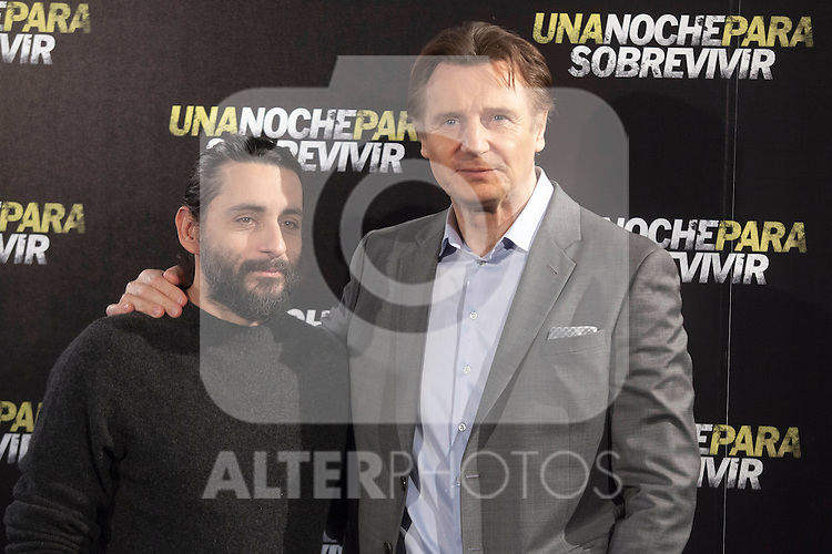 Spanish director Jaume Collet, left, and Irish actor Liam Neeson, right, pose for photographers during the presentation of the film 'Run All Night' in Madrid on Tuesday, March 24, 2015. (ALTERPHOTOS / Nacho Lopez)
