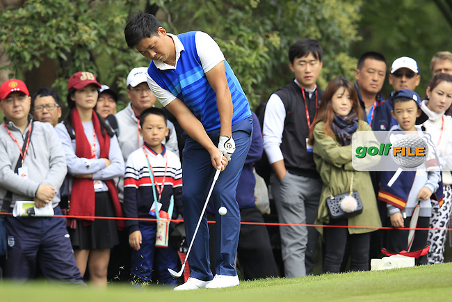 Zhang Xinjun (CHN) on the 4th green during the final round of the WGC-HSBC Champions, Sheshan International GC, Shanghai, China PR.  30/10/2016<br /> Picture: Golffile | Fran Caffrey<br /> <br /> <br /> All photo usage must carry mandatory copyright credit (&copy; Golffile | Fran Caffrey)