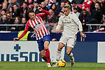 Atletico de Madrid's Santiago Arias and Real Madrid's Mariano Diaz during La Liga match between Atletico de Madrid and Real Madrid at Wanda Metropolitano Stadium in Madrid, Spain. February 09, 2019. (ALTERPHOTOS/A. Perez Meca)
