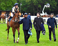 Winner of The Shadwell Racing Excellence Apprentice Handicap Handytalk (r) ridden by Oliver Searle and trained by Rod Millman is led into the Winners enclosure during Evening Racing at Salisbury Racecourse on 11th June 2019