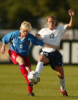 Svetlana Sedakova of Russia battles Kristine Lilly for the ball. The USWNT defeated Russia 5-1 on  September 29, at Mitchel Athletic Complex, Uniondale, NY.