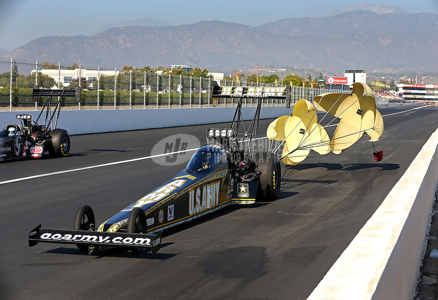Nov 9, 2013; Pomona, CA, USA; NHRA top fuel dragster driver Tony Schumacher during qualifying for the Auto Club Finals at Auto Club Raceway at Pomona. Mandatory Credit: Mark J. Rebilas-