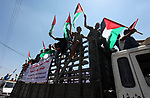 Palestinians take part in a protest calling for end the Israeli blockade on Gaza Strip, in the east of Gaza city, on July 22, 2019. Demonstrators demand an end to Israel's 12-year blockade of the Gaza Strip, which has shattered the coastal enclave's economy and deprived its two million inhabitants of many basic amenities. Photo by Mahmoud Ajjour