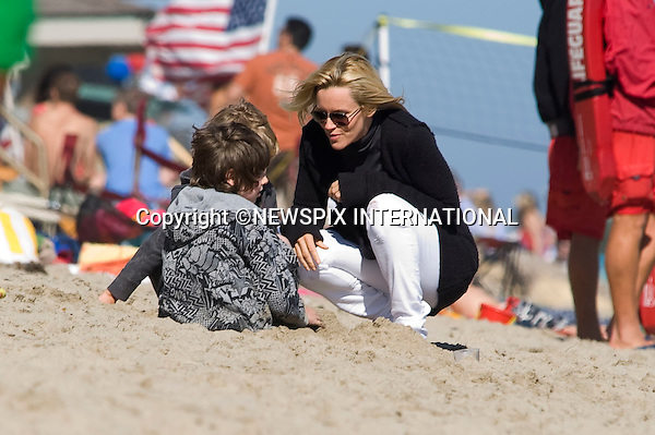 "JIM CARREY AND JENNY McCARTHY .celebrate Independence Day with Children, at Jim Carrey's Malibu beach house. Malibu_04/07/2009.Mandatory Photo Credit: ©Dias/Newspix International..**ALL FEES PAYABLE TO: ""NEWSPIX INTERNATIONAL""**..PHOTO CREDIT MANDATORY!!: NEWSPIX INTERNATIONAL(Failure to credit will incur a surcharge of 100% of reproduction fees)..IMMEDIATE CONFIRMATION OF USAGE REQUIRED:.Newspix International, 31 Chinnery Hill, Bishop's Stortford, ENGLAND CM23 3PS.Tel:+441279 324672  ; Fax: +441279656877.Mobile:  0777568 1153.e-mail: info@newspixinternational.co.uk"