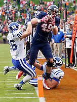 Virginia tight end Zachary Swanson (49) Duke safety Corbin McCarthy (26) Duke defeated Virginia 35-22 at Scott Stadium in Charlottesville, VA. . Photo/Andrew Shurtleff