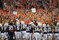 Jan 10, 2011; Glendale, AZ, USA; Auburn Tigers fans in the crowd hold signs against the Oregon Ducks during the 2011 BCS National Championship game at University of Phoenix Stadium. The Tigers defeated the Ducks 22-19. Mandatory Credit: Mark J. Rebilas-