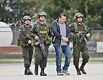 """Colombia's policemen escort to Costa Rican Alejandro Jimenez, also known as """"Palidejo"""" suspected of ordering the murder of Argentine folk singer Facundo Cabral during his extradition process in Bogota, Colombia. 13/03/2012.  Photo by Nestor Silva / VIEWpress."""