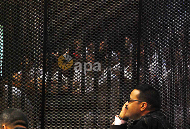 Egyptian defendants on case of the deaths in a riot following a football match in Port Said in February 2012, sit behind bars sit behind bars during their trial in Cairo on May 24, 2015. According to reports the Egyptian court upheld 11 death sentences for defendants at their retrial in the case of 74 deaths in clashes between football fans in February 2012, though the sentences still need to be referred to Egypt's Grand Mufti and the verdict can be appealed. Photo by Stringer