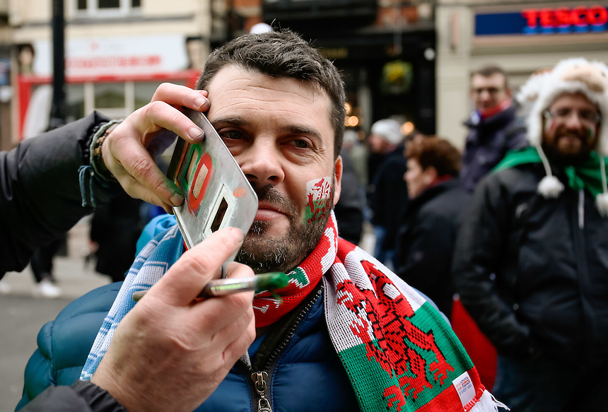 An Italy fan having face paint applied<br /> <br /> Photographer Simon King/CameraSport<br /> <br /> International Rugby Union - RBS 6 Nations Championships 2016 - Wales v Italy - Saturday 19th March 2016 - Principality Stadium, Cardiff <br /> <br /> &copy; CameraSport - 43 Linden Ave. Countesthorpe. Leicester. England. LE8 5PG - Tel: +44 (0) 116 277 4147 - admin@camerasport.com - www.camerasport.com