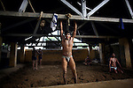 Indian men practice traditional Kushti wrestling on Monday, June 01, 2009 in New Delhi, India...---------------------..Story Synopsis:  Kushti, India's indigenous form of wrestling, has gone from a royal national sport to a dying art in Asia over the past century.  Those who still practice it meet the lengthy hours of its daily regimen with unrelenting devotion -- rope, aerobic and weight exercises; culturing the soil on which they wrestle; a diet comprised of non-spicy, self-made food; and celibacy.  And so, in traditional earthen pits wrestlers still apply the physical and mental intensity that has driven their ancestors for three thousand years.  But a 2004 decision by the Indian Fighters Federation from the capital of Delhi, prohibiting fighting on red soil and ordering fight clubs to use mattresses instead, exacerbated Kushti's diminishing role in Indian tradition.  The order was in part an effort to gather more Olympic medals -- the first by Khashaba Dadasaheb Jadhav, a bronze in 1952, and most recently, also a bronze at the 2008 Beijing Olympics, by Sushil Kumar.